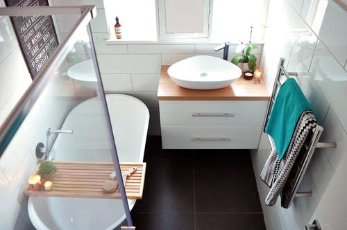 use a bath caddy for extra bathroom storage