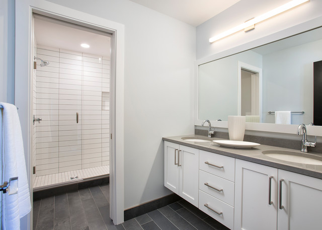 Example of a mid-sized trendy 3/4 doorless shower design in Minneapolis with flat-panel cabinets and white cabinets
