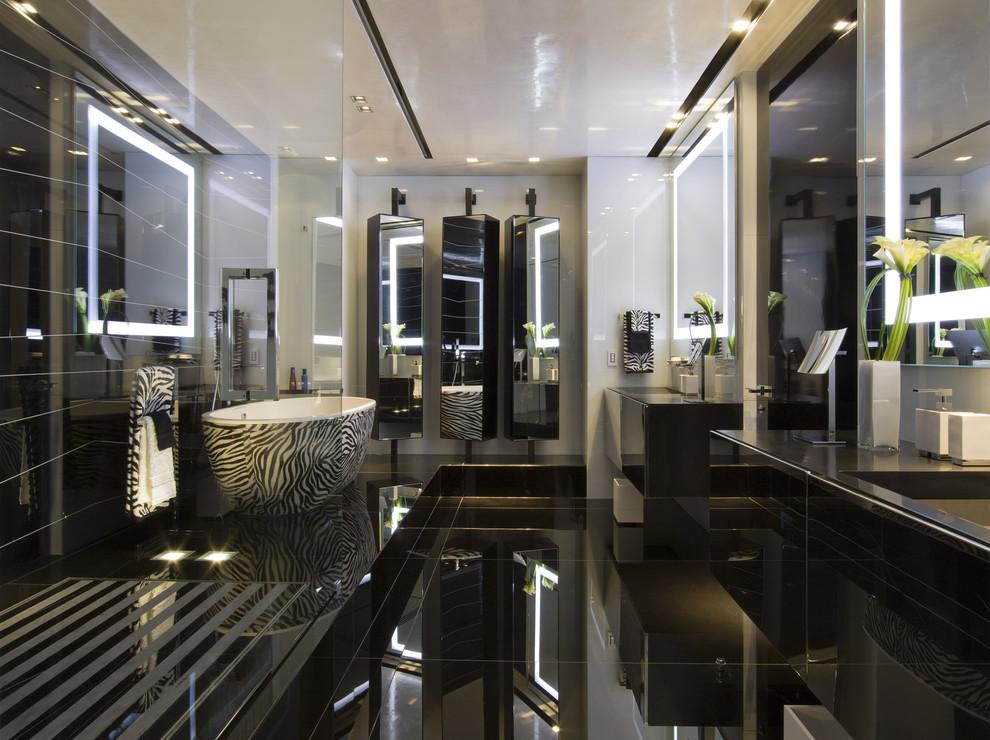 Example of a minimalist black floor freestanding bathtub design in Miami