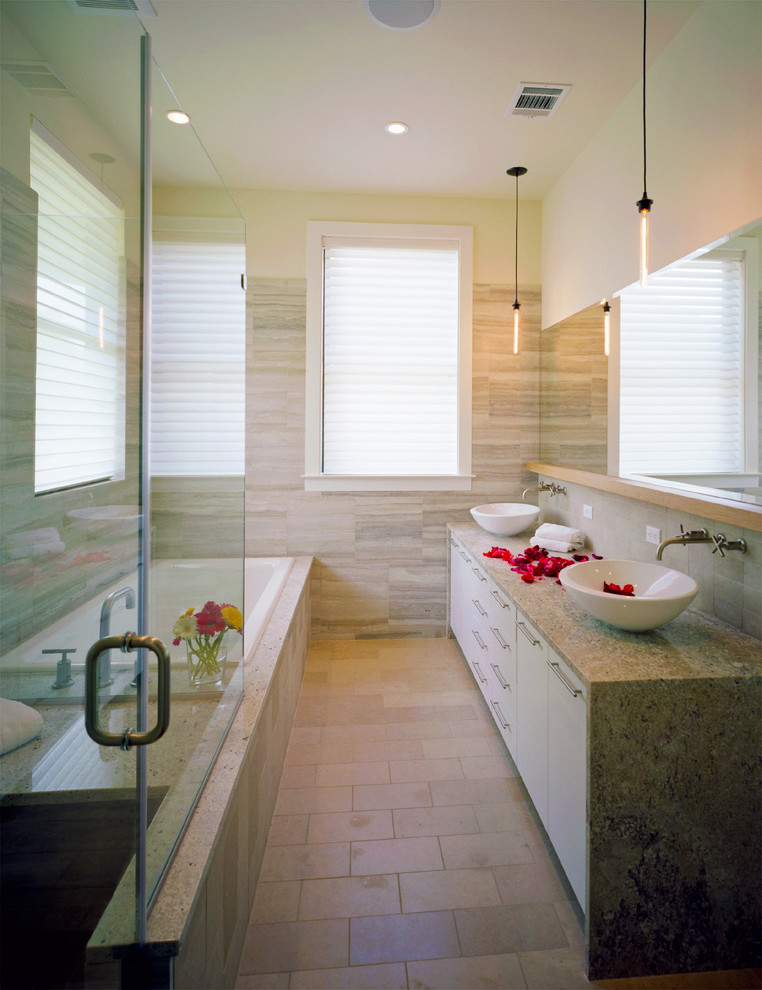 Example of a trendy bathroom design in Austin with granite countertops and a vessel sink