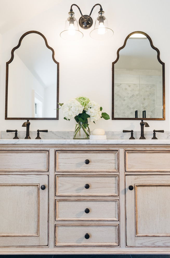 Bathroom - mid-sized traditional master white tile and stone tile bathroom idea in New York with beaded inset cabinets, distressed cabinets, a one-piece toilet, white walls, an undermount sink and marble countertops