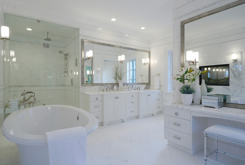 Two Beveled Mirrors Complement The Clic Style Of Bathroom Instead Having A White Framed Mirror An Antiqued Serves As Gl Frame
