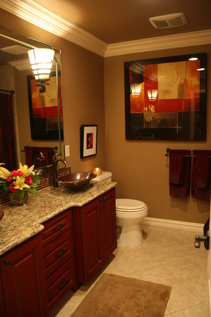 Copper vessel sinks, cranberry distressed cabinets, curved granite countertop