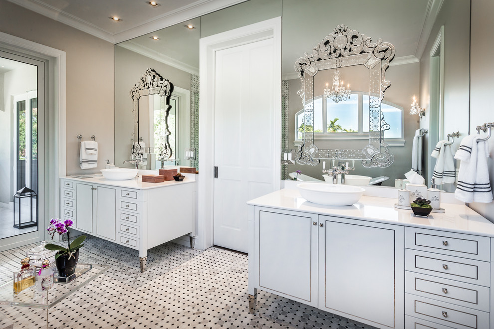 Bathroom - large traditional master stone tile and white tile marble floor bathroom idea in Miami with a vessel sink, furniture-like cabinets, white cabinets, quartzite countertops, a one-piece toilet and gray walls