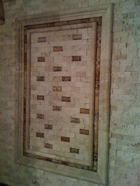 Cork and Split Face Travertine Backsplash traditional-bathroom