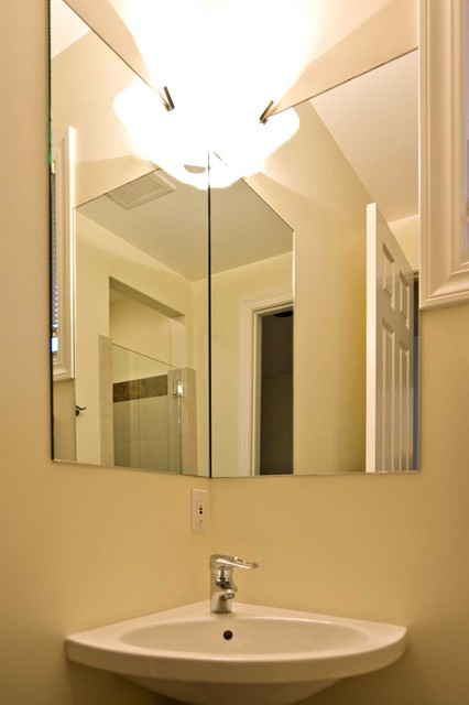 corner sink and corner mirror in small bathroom contemporary bathroom