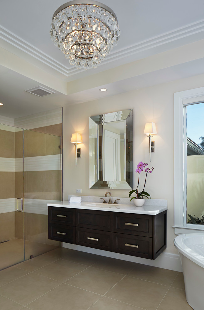 Bathroom - transitional beige tile bathroom idea in Miami with dark wood cabinets