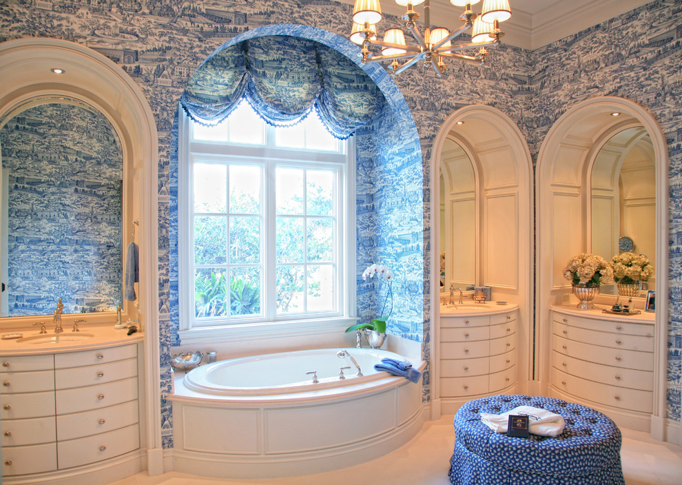 Drop-in bathtub - victorian beige tile drop-in bathtub idea in Miami with an undermount sink, flat-panel cabinets, beige cabinets and blue walls