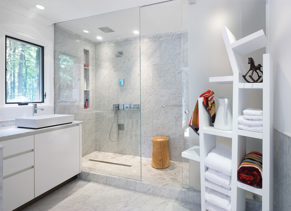 Example of a mid-sized trendy master white tile and marble tile marble floor and gray floor bathroom design in DC Metro with a vessel sink, flat-panel cabinets, white cabinets, marble countertops, white walls and gray countertops