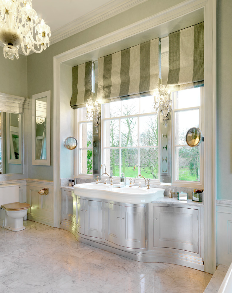 Example of a classic master bathroom design in Other with an integrated sink, furniture-like cabinets, a two-piece toilet and green walls