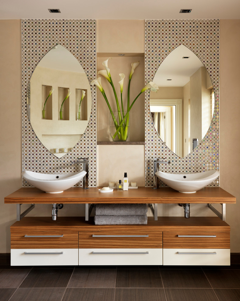 Example of a large trendy master multicolored tile and mosaic tile bathroom design in London with a vessel sink and beige walls