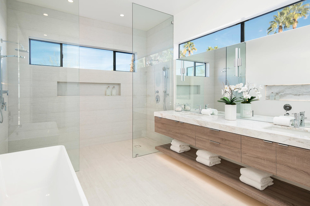 Example of a trendy master beige tile beige floor bathroom design in Other with flat-panel cabinets, medium tone wood cabinets, white walls and an undermount sink