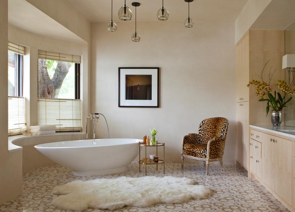 Example of a trendy freestanding bathtub design in Austin