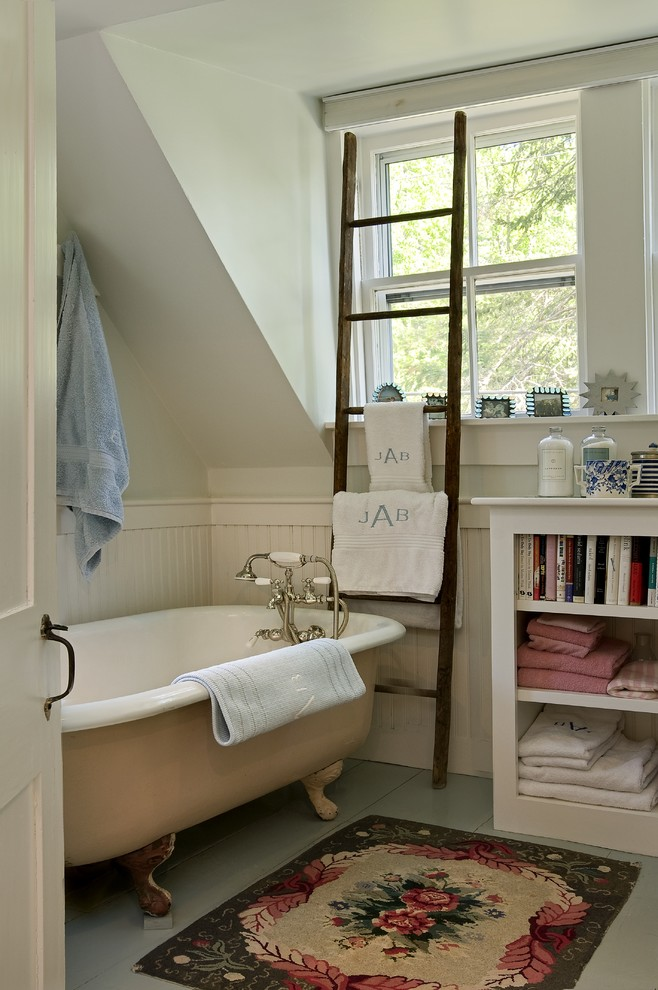 Inspiration for a traditional bathroom in Burlington with open cabinets and a claw-foot bath.