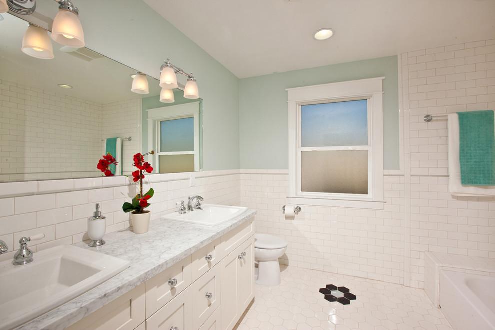 Bathroom - traditional bathroom idea in San Diego with marble countertops