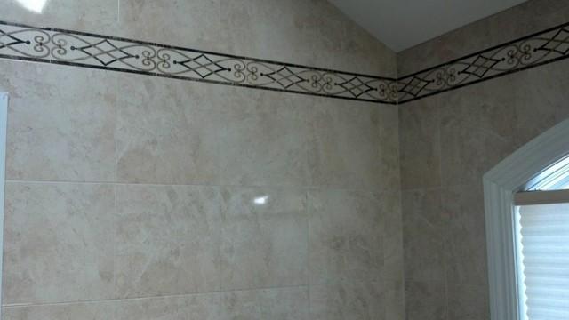 Cream Marble with Intricate Emperador Mosaic traditional-bathroom