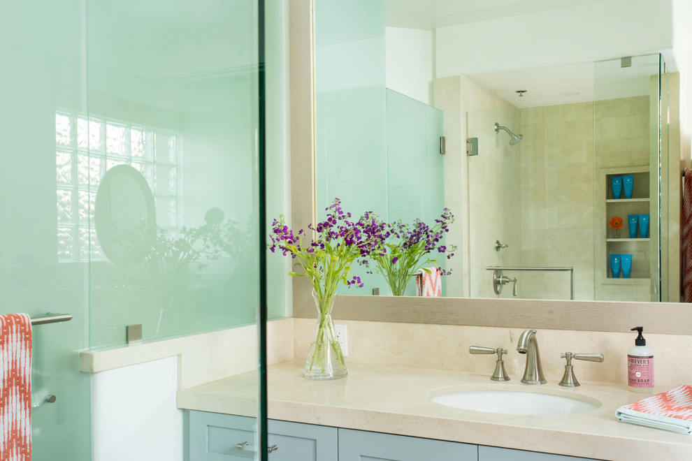 Inspiration for a large coastal kids' beige tile and marble tile light wood floor and gray floor alcove shower remodel in Los Angeles with shaker cabinets, blue cabinets, a one-piece toilet, white walls, an undermount sink, marble countertops and a hinged shower door