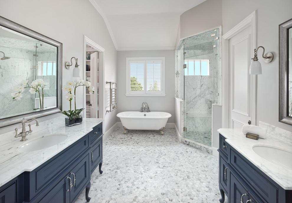 Crisp Master Bathroom with Navy Blue Freestanding Vanities ...