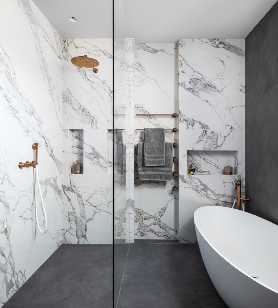 Mid-sized trendy kids' gray tile double-sink walk-in shower photo in London with recessed-panel cabinets, dark wood cabinets, gray walls, a drop-in sink, marble countertops, white countertops and a floating vanity