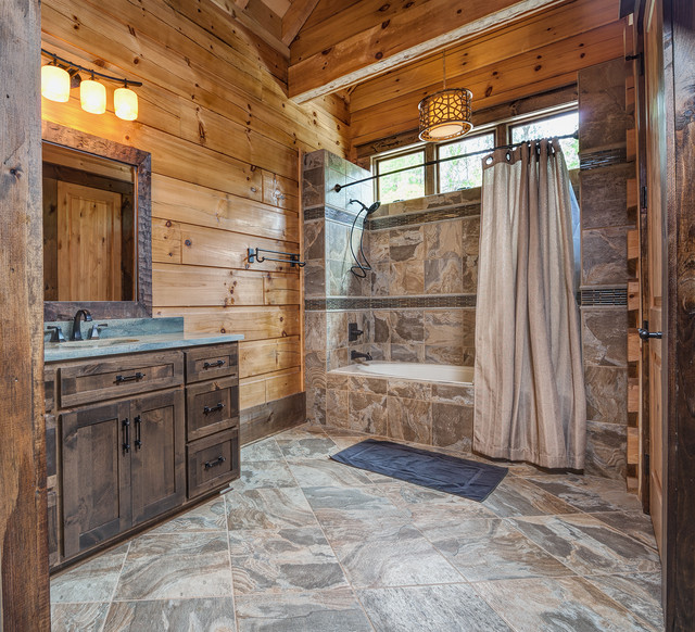 Example Of A Mountain Style Brown Tile Bathroom Design In Other With An Undermount Sink
