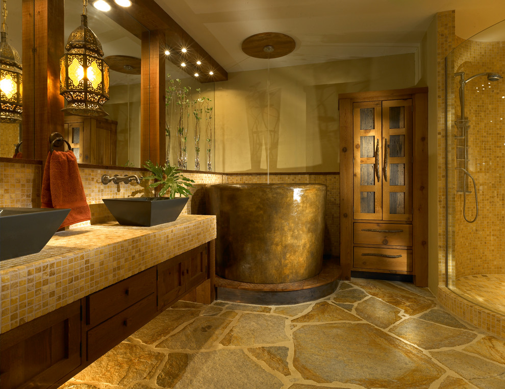 Bathroom - mid-sized rustic master mosaic tile and brown tile slate floor bathroom idea in Orlando with a vessel sink, tile countertops, shaker cabinets, dark wood cabinets, beige walls and yellow countertops