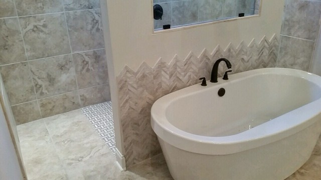 Large trendy master ceramic tile ceramic floor bathroom photo in New Orleans with beige walls, raised-panel cabinets, white cabinets and granite countertops