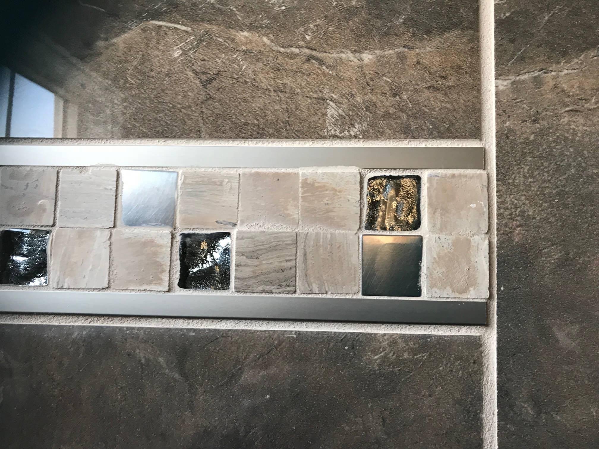 Custom  Ceramic Tile Tub Surround with inlaid tile design
