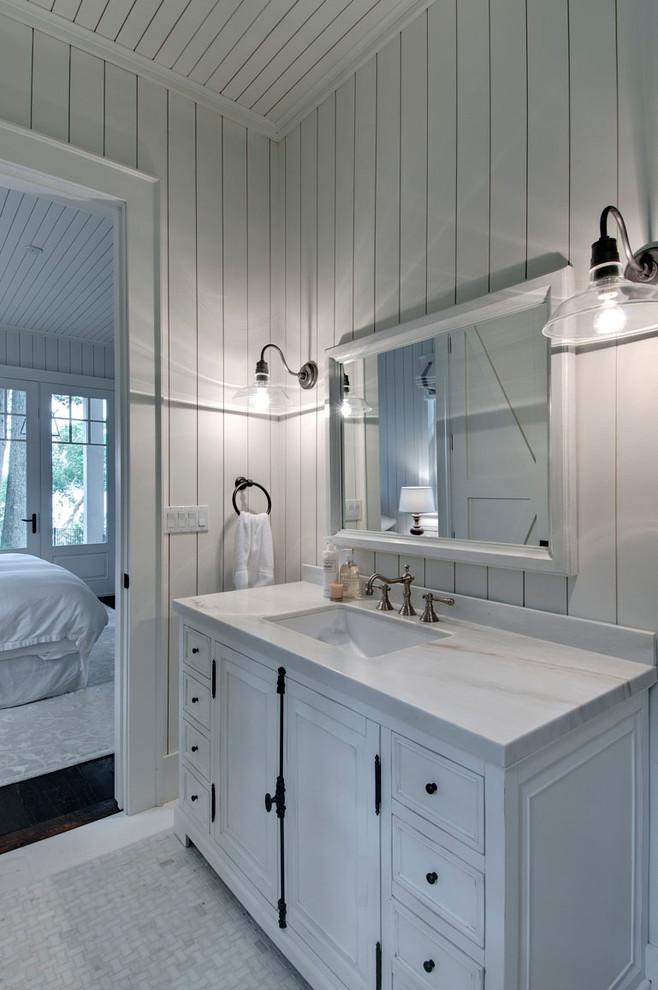 Bathroom - coastal mosaic tile floor bathroom idea in Toronto with an undermount sink and white cabinets