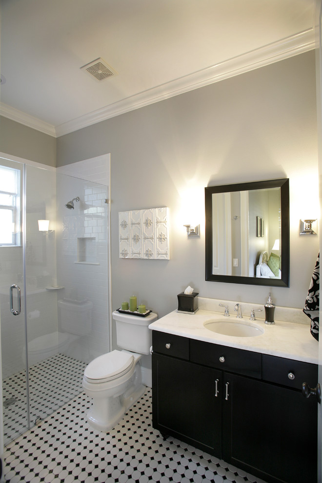Example of a trendy subway tile walk-in shower design in Tampa