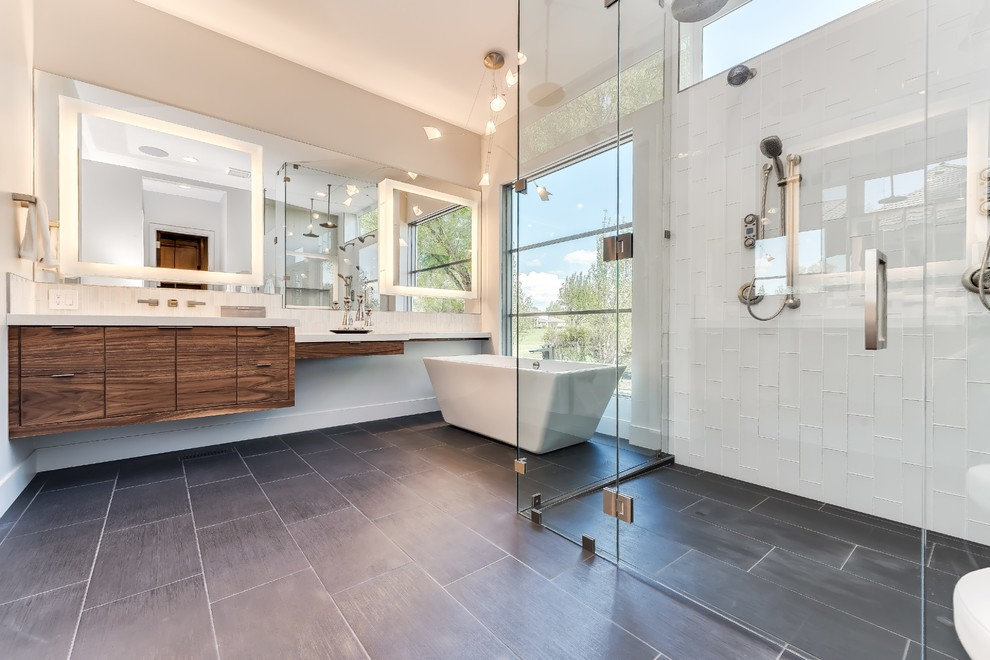 Trendy master white tile gray floor bathroom photo in Other with flat-panel cabinets, dark wood cabinets, white walls and a hinged shower door
