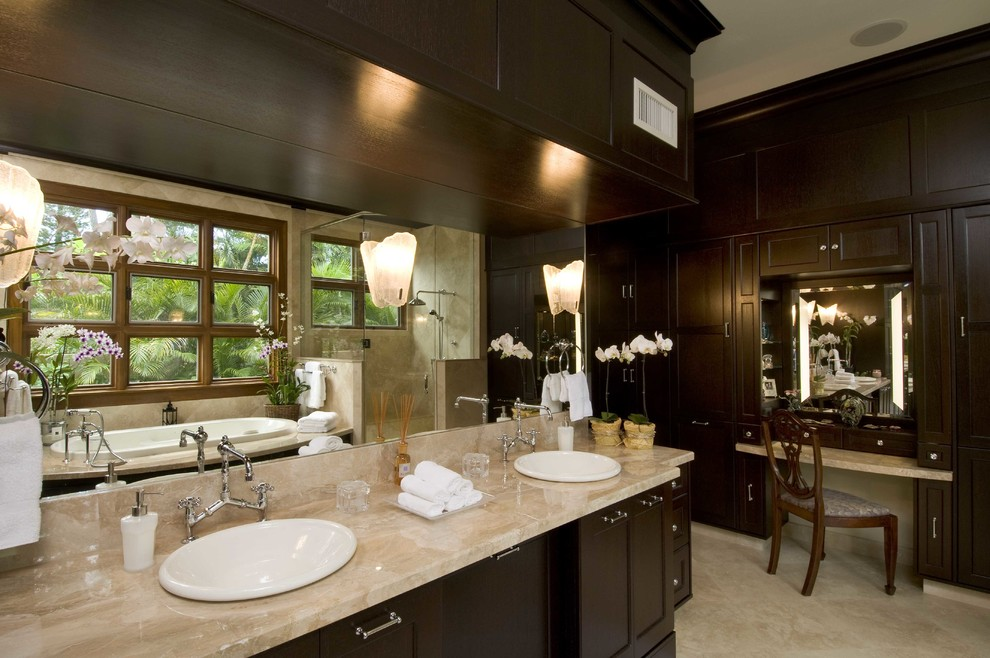 Example of a mid-sized island style master beige tile and cement tile ceramic tile and gray floor bathroom design in Hawaii with flat-panel cabinets, beige cabinets, an undermount tub, beige walls, quartz countertops and beige countertops