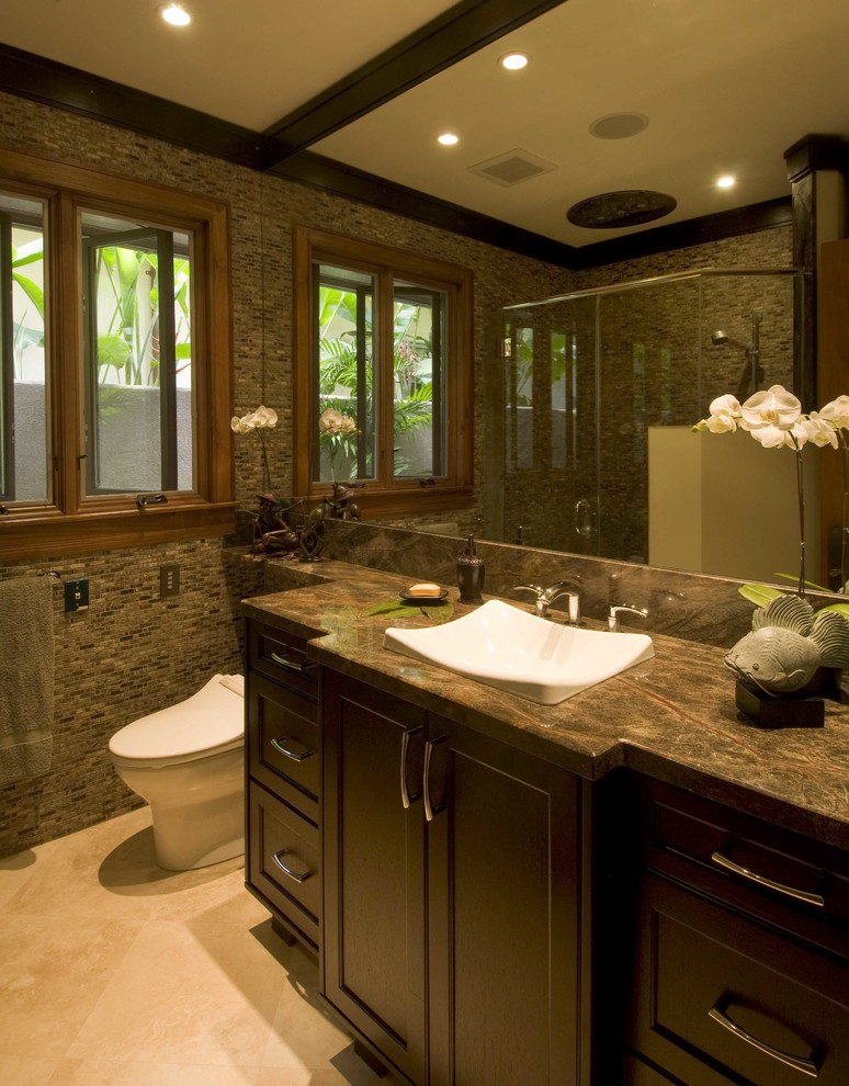 Mid-sized island style master beige tile and cement tile ceramic tile and gray floor bathroom photo in Hawaii with flat-panel cabinets, beige cabinets, an undermount tub, beige walls, a vessel sink, quartz countertops and beige countertops