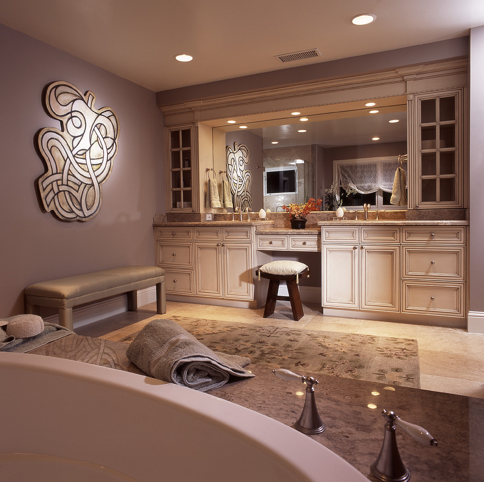 Example of a mid-sized transitional master beige tile and cement tile ceramic tile and gray floor bathroom design in Hawaii with flat-panel cabinets, beige cabinets, an undermount tub, beige walls, a vessel sink, quartz countertops and beige countertops