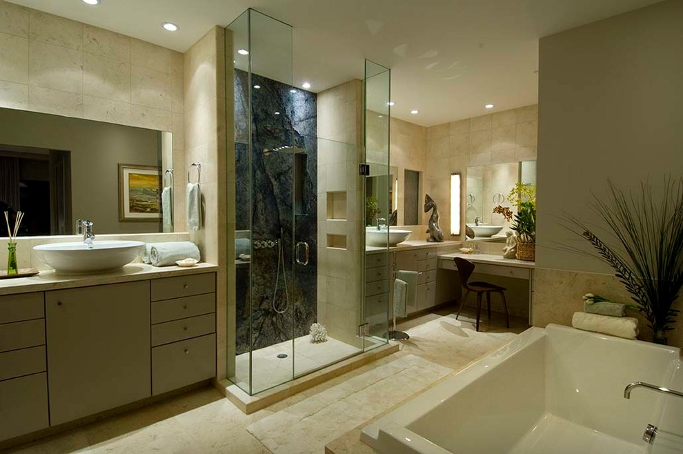Bathroom - mid-sized contemporary master blue tile and stone slab ceramic tile and beige floor bathroom idea in Hawaii with flat-panel cabinets, gray cabinets, beige walls, a vessel sink, granite countertops, a hinged shower door and beige countertops