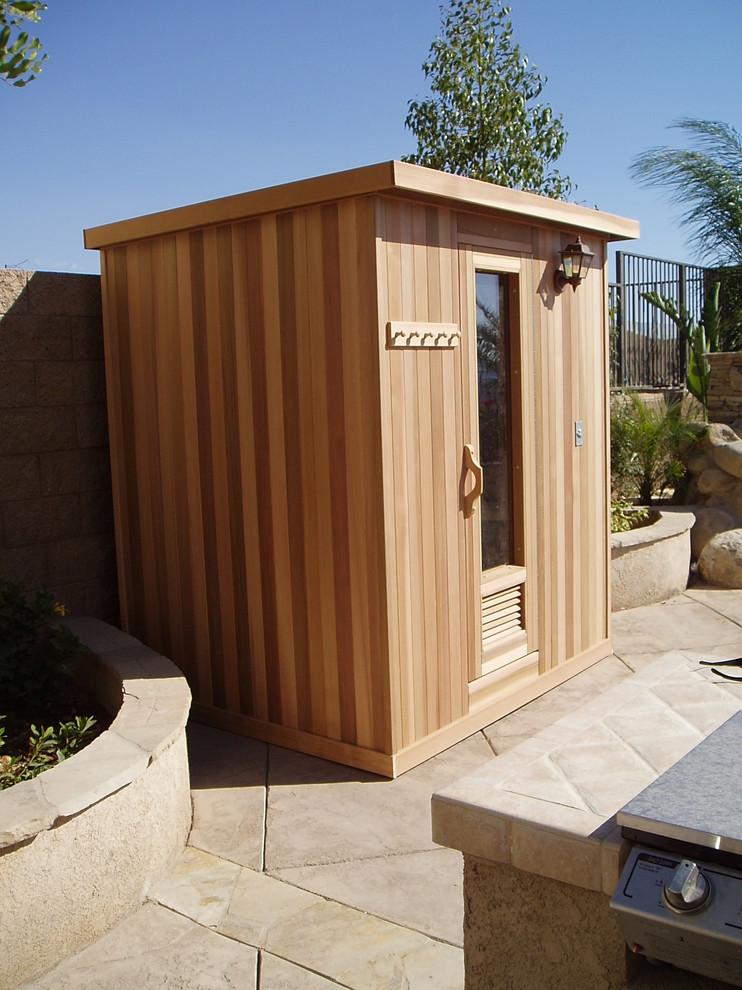 Mid-sized trendy medium tone wood floor and brown floor sauna photo in Los Angeles with brown walls