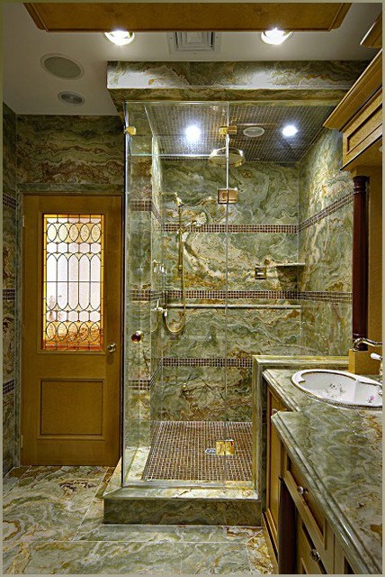 Custom steam shower with Onyx Slabs and glass tile accents eclectic-bathroom