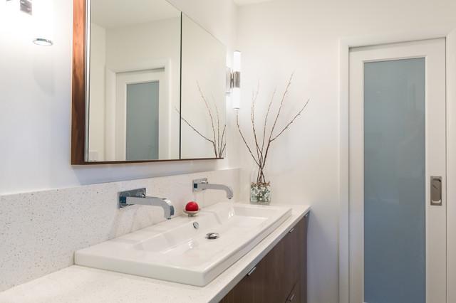 A Custom Walnut Vanity With Washbasin And Chipped Ice Quartz Countertops  Contemporary Bathroom