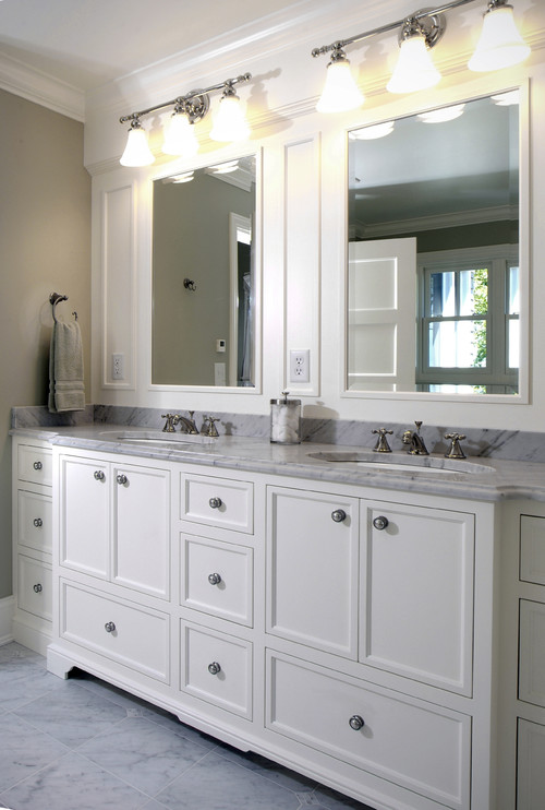 i like the lights on this bathroom as well and the way the molding around the mirrors camouflages the outlets making it look all like one piece