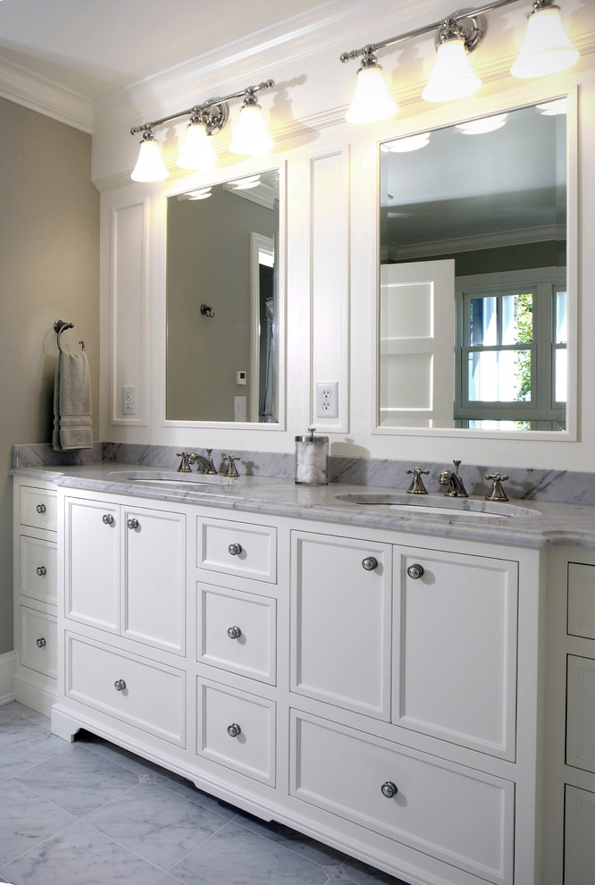Example of a large classic master marble floor bathroom design in Grand Rapids with marble countertops, recessed-panel cabinets, white cabinets, beige walls and an undermount sink