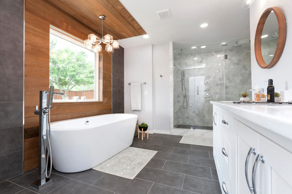 Inspiration for a large contemporary master gray tile and marble tile slate floor and gray floor bathroom remodel in Dallas with shaker cabinets, white cabinets, gray walls, an undermount sink, quartz countertops, a hinged shower door and white countertops