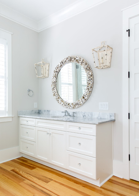 Inspiration for a mid-sized timeless master gray tile and marble tile light wood floor and beige floor bathroom remodel in Charleston with white cabinets, an undermount sink, recessed-panel cabinets, white walls, marble countertops and a hinged shower door