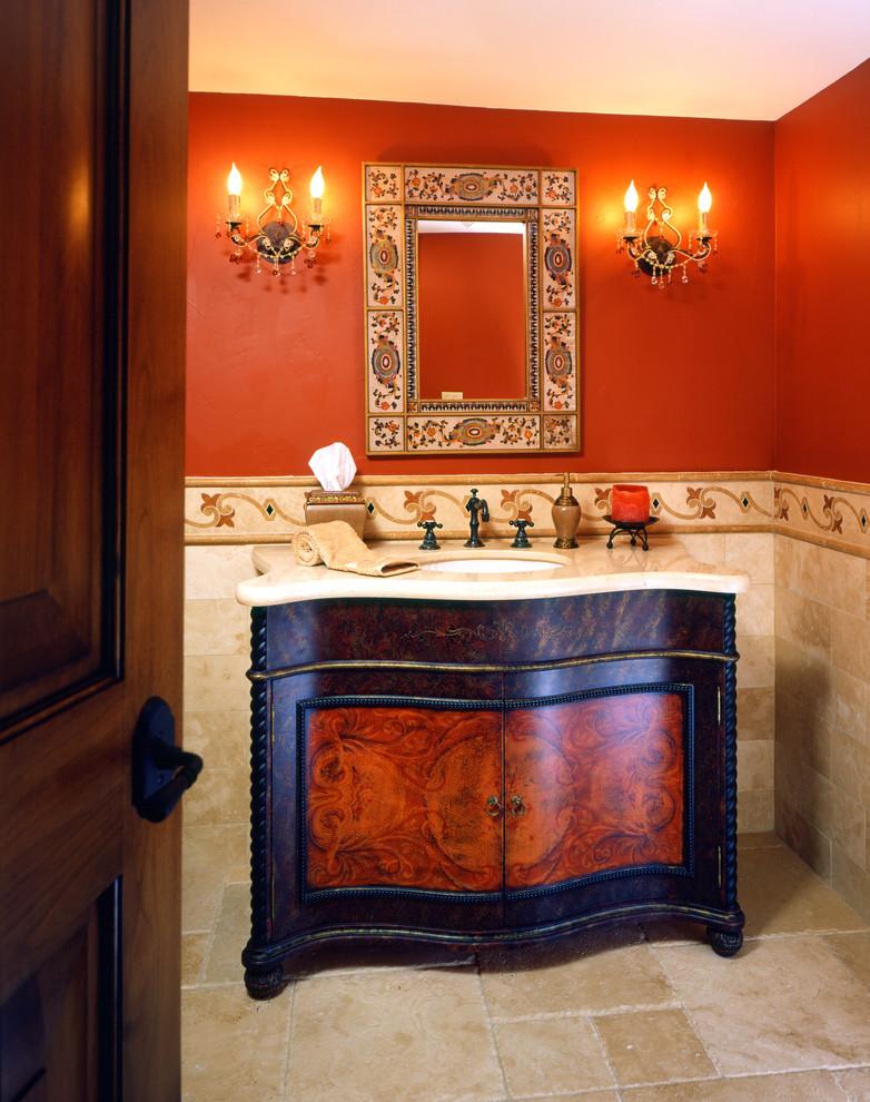 Bathroom - bathroom idea in San Francisco with marble countertops and red walls