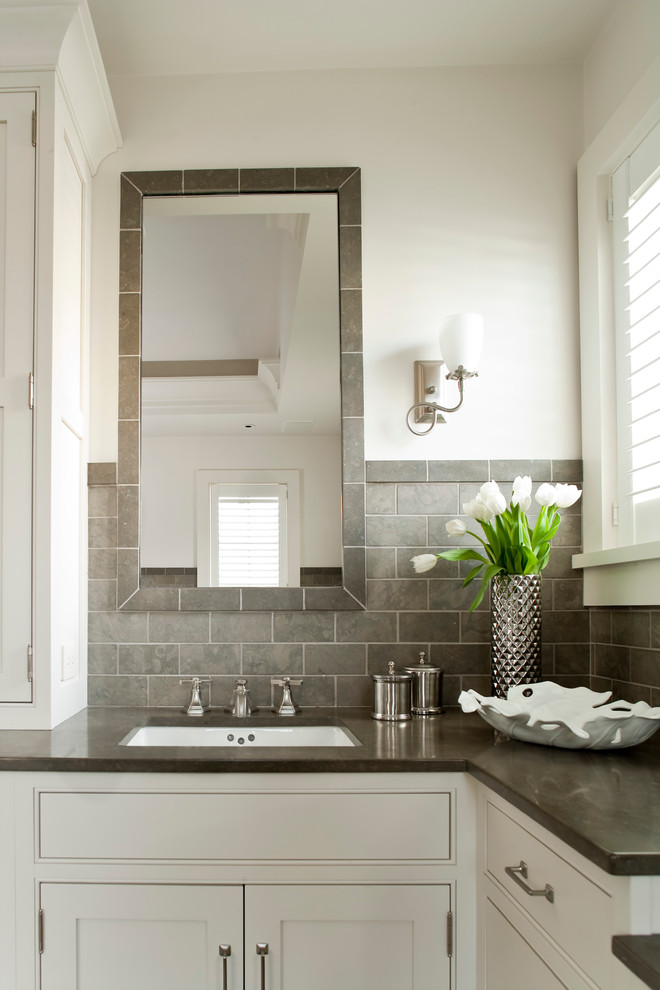 Freestanding bathtub - coastal master gray tile and subway tile ceramic tile freestanding bathtub idea in Bridgeport with recessed-panel cabinets, white cabinets, white walls and an undermount sink