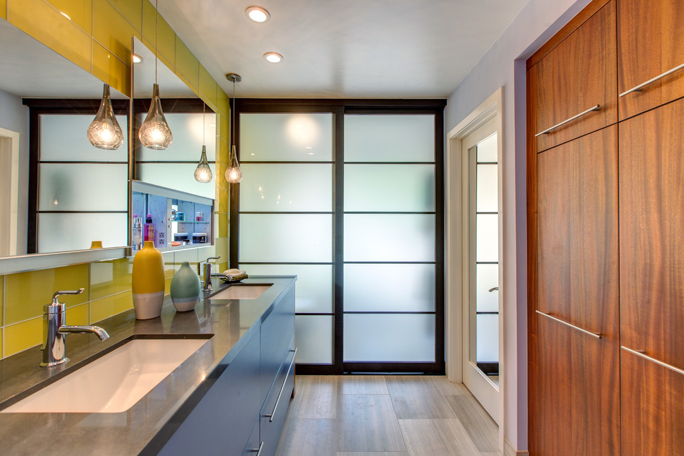 Trendy yellow tile and glass tile bathroom photo in San Diego with an undermount sink, flat-panel cabinets and gray walls