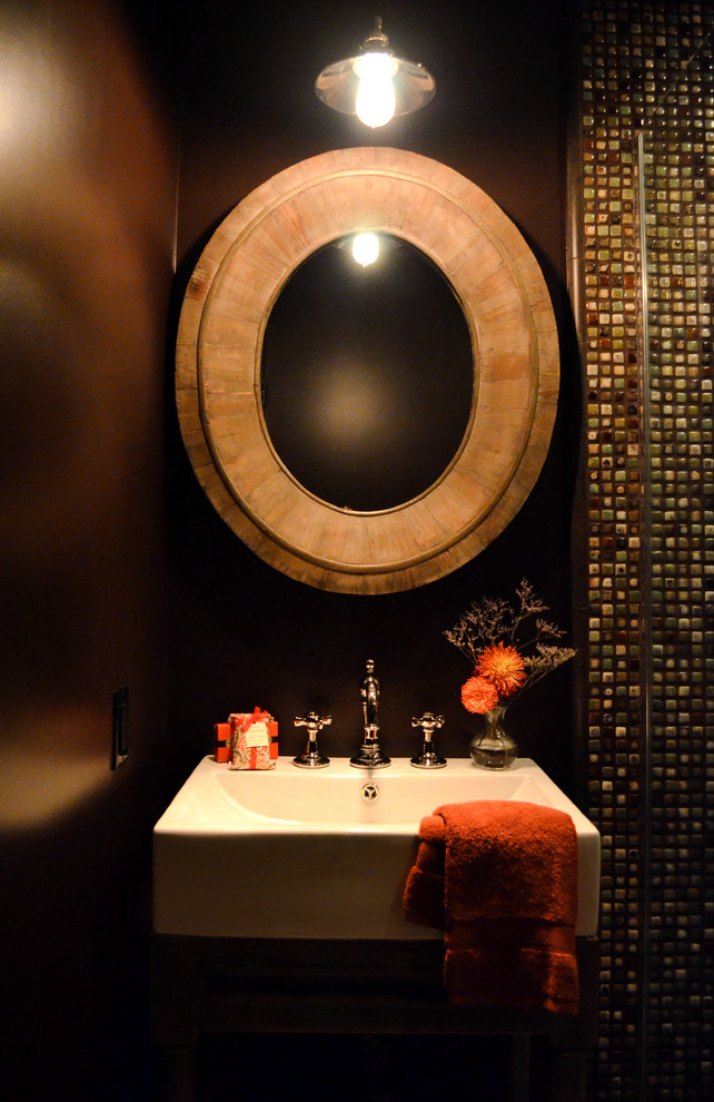 Small tuscan 3/4 multicolored tile and ceramic tile porcelain tile and beige floor corner shower photo in Los Angeles with open cabinets, medium tone wood cabinets, a two-piece toilet, brown walls, a vessel sink and a hinged shower door