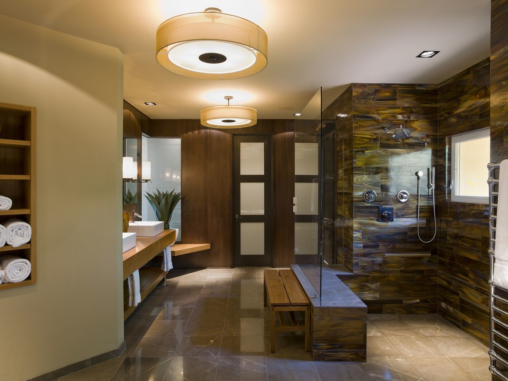 Inspiration for a contemporary bathroom remodel in Austin with a vessel sink
