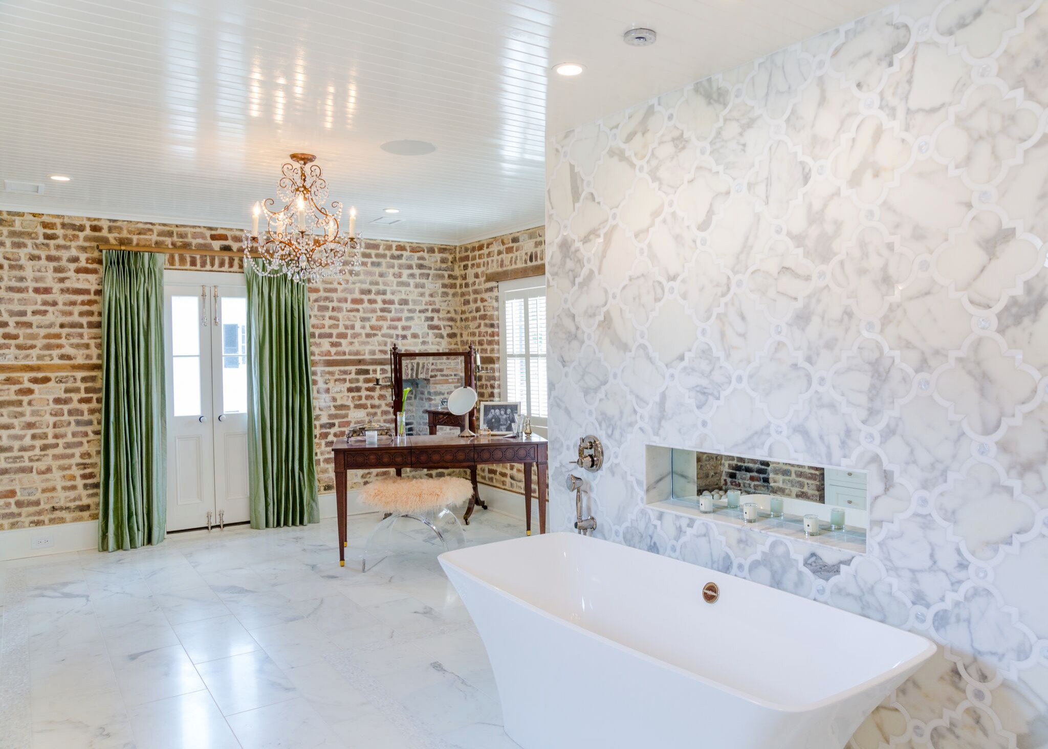 DAZZLING feature tile wall behind the tub.