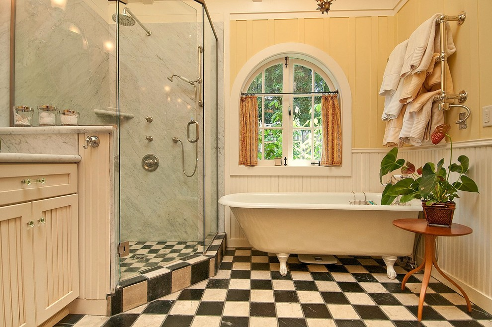 Inspiration for a timeless multicolored floor claw-foot bathtub remodel in Seattle