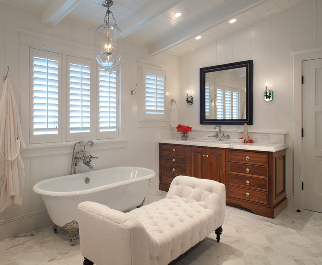 Inspiration for a beach style claw-foot bathtub remodel in Phoenix with marble countertops