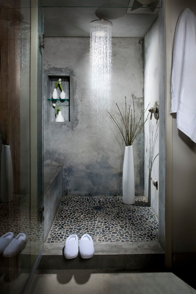 Urban gray tile pebble tile floor alcove shower photo in San Francisco with gray walls